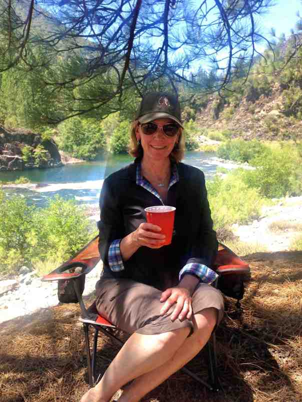 Enjoying a cocktail by the river.