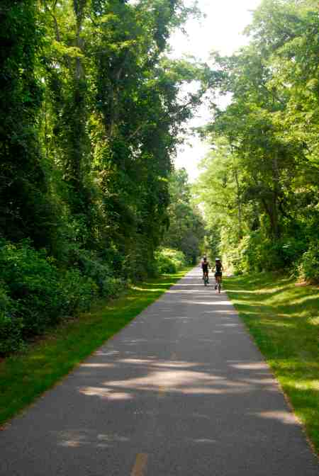 Annie and Andrea riding free and easy along the Shining Sea Bikeway.