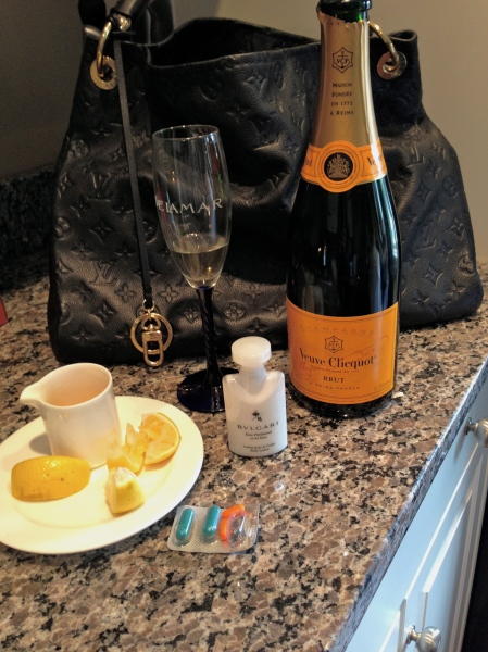 The Bride's Survival Kit:  Lemon, Honey, Motrin and Tylenol, Bulgari Lotion, Champers, High-quality leather product.