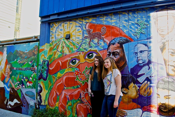 8 Girls in front of murals