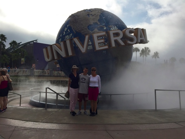 1 in front of universal globe